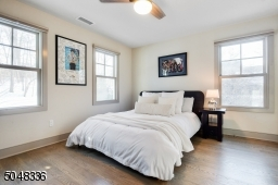 Features hardwood floors, deep baseboard moldings, ceiling fan and double fitted closet
