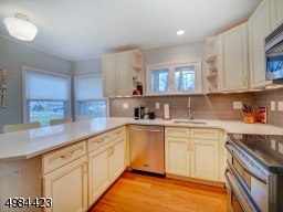 Updated Kitchen w/off white Cabinets and Stainless Appliances