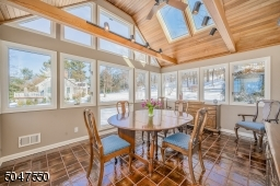 Sun filled dining room with skylights