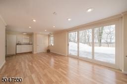 Expansive recreation area, half bath and storage room