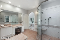 Steam shower, Jetted tub, Dressing area , Mini wet bar, two walk in closets