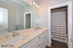 Shower over tub and double sink vanity