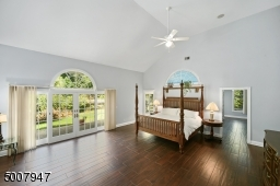 Master bedroom overlooking backyard. Lots of closet space and dressing area.