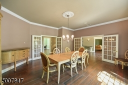 Dining room with 2 sets of French doors.