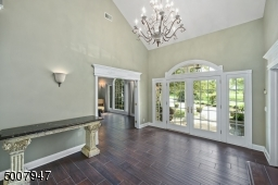 Enter through the beautiful glass front doors into a large foyer.