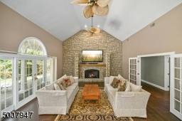 Family room with floor to ceiling stone gas fireplace