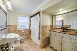 Full hall bath with shower-tub combo