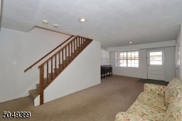 Exit to Covered Porch, Garage and Utility Room