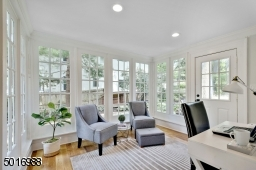 This light filled sunroom just off the kitchen makes a perfect home office with access to the bluestone patio.
