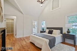 Retreat to this luxurious master suite with soaring ceilings, feature chandelier, fireplace, spa-like marble bath, walk-in closet, extra closet and a secret bonus tower loft studio space.