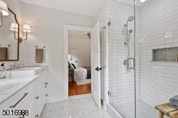 Enjoy the luxury of this walk-in shower with marble floors, handmade-look subway tile, large marble shampoo niche, custom shower glass and Kohler plumbing fixtures.  Designed by Clear Space Home.