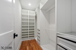 This master closet has it all... ample double hang space, 8 deep drawers, pullout jewelry trays topped with glass shelves, 2 shoe towers and extra storage shelves.