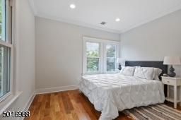 This spacious front bedroom gets the most sparkling natural light!