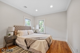 This back bedroom overlooks a lushly landscaped backyard and it has a large double closet.