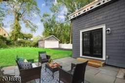 Kick back and relax in this secluded bluestone patio overlooking a lushly landscaped backyard.
