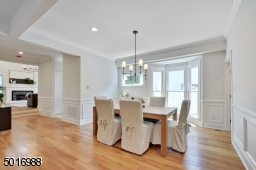 This open concept dining room to kitchen flows into the family room.  Finished basement entrance is just off dining room.
