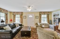 Family room, hardwood floor, door to patio, built in bookcase