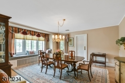 Formal dining room, hardwood floor, window seat and leads to Bulter's Pantry