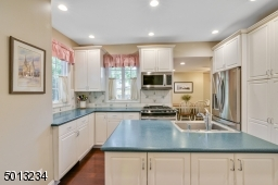 White cabinets with stainless appliances, custom draws and cabinets, pantry with pull out draws