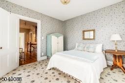 Single closet, wall to wall carpet