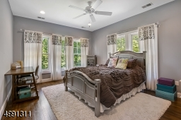 Views to the rear and side grounds are seen from this window-filled room including walk-in custom closet and bath.