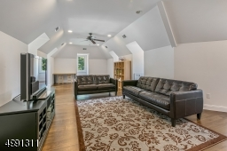 This 31 x 14-ft. space is a finished area over the 4-car garage. Features include dormer windows, hardwood flooring, recessed lighting, ceiling fan. Also, a separate office/den area with storage.