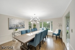 Gorgeous dining room with bay window.