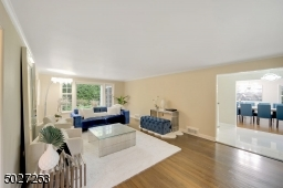 Formal living room with gorgeous windows offering sun kissed views of the yard.