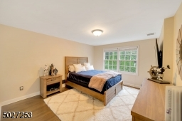One of 5 bedrooms with hardwood flooring and walk in closet.