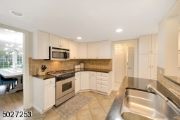 Kitchen with granite counter-tops and stainless steel appliances.