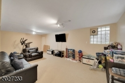 The lower level offers a playroom on one side and finished game room on the other.   Additional unfinished space is also available for storage.