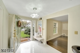 Stunning front entry with new marble floor.