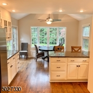 Large eat in kitchen overlooking tranquil backyard