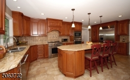 Counter-tops, Roll-outs, Tiled Flooring, & Recessed Lighting.