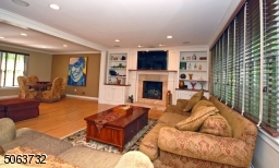 Gleaming Wood Floors on Both First Floor & Second Floor, Built ins, Gas fireplace, Surround sound system & Recessed Lighting.