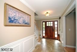 Area. Solid Wood Door. Crown Moldings and Beautiful Wood Trim.