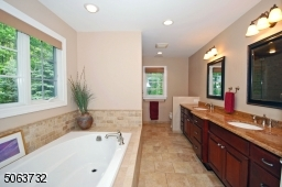 including Bench & multiple shower accessories. Soaking Tub. Double Sink Vanity.