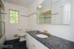 Granite Counter-top & Triple Mirror.