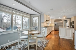 This breakfast nook had been extended to enhance this amazing kitchen.