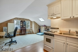 How great is this! a studio with kitchen and half bathroom. Access through the laundry room.