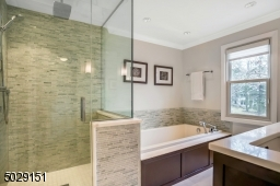 It doesn't get better then this! heated floors, Hansgrohe jets & rain shower.  Toto toilet too!