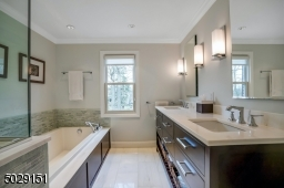 Complete with custom cabinetry and marble tile and countertops. You will love it!