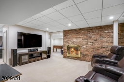 Ok, finished LL with wood burning fireplace accented with a beautiful brick wall, exercise area - and outdoor entrance by the driveway.