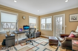 This 1st floor office has a cute balcony attached.  Work from home- and relax too!