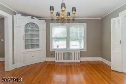 Beautiful hardwood flooring; built-in corner cabinet