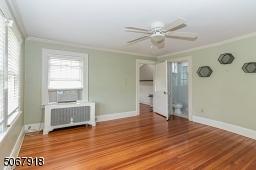Beautiful hardwood flooring; ceiling fan