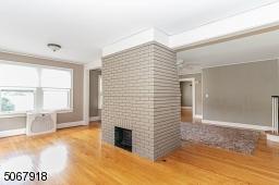 Hardwood flooring; wood-burning fireplace