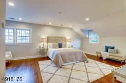The Master Bedroom suite is on its own level. Spacious bedroom features a sitting area and luxury en suite bath. The bedroom has special sound-proof insulation.