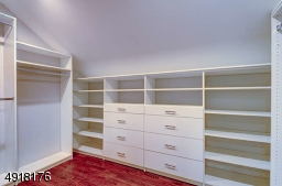 Enjoy a huge walk in closet with custom designed organizers. Available to the Master Suite on the landing of this level is a large laundry room.