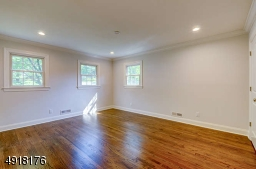 Bright, corner bedroom, one of 3 bedrooms on this level - features attractive en suite bath, refinished wood floor, recessed lighting, two closets. All bedrooms are wired for cable.